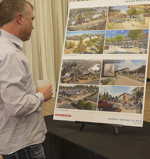 Grass Valley's James Arbaugh studies an artist's rendering of the project.