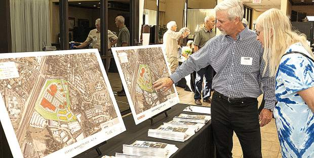 Warren Hughes, left, is the project manager for the proposed Dorsey Marketplace development near the intersection of Dorsey Drive and the Golden Center Freeway in Grass Valley. Hughes was on hand Wednesday afternoon at the Foothills Event Center, holding an open house regarding the proposal. Grass Valley's Beverly Powell, right, was on hand to ask questions.