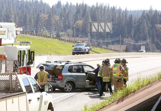 Grass Valley firefighters assist with the scene of Wednesday afternoon's multiple vehicle collision under the Dorsey overpass after a logging truck damaged the bridge emitting a shower of concrete to the southbound lanes of the Golden Center Freeway.