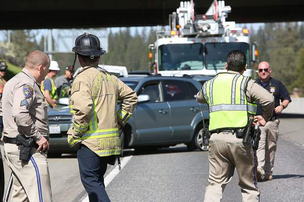 CHP officers and Grass Valley firefighters assist at the scene of a multiple vehicle collision under the Dorsey overpass Wednesday afternoon.
