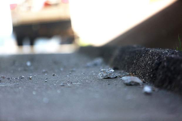 Chunks of concrete sit on the southbound shoulder of the Golden Center Freeway after being struck by the boom of a passing logging truck Wednesday afternoon under the Dorsey overpass.