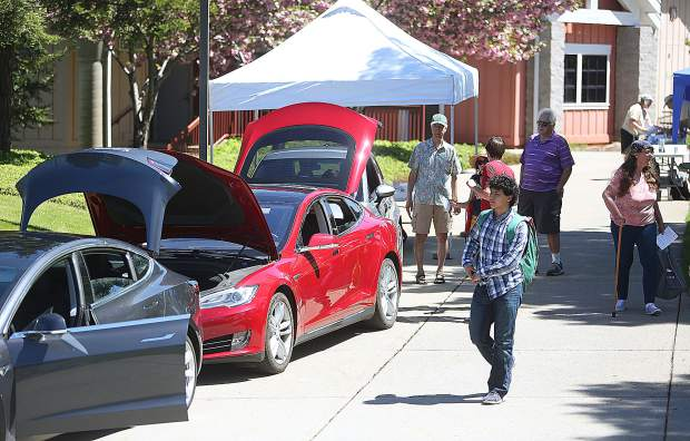 Informational booths and displays, including these Tesla electric vehicles, were available for Sierra College students and members of the community to peruse during the Earth Day and Health Fair event last Thursday.