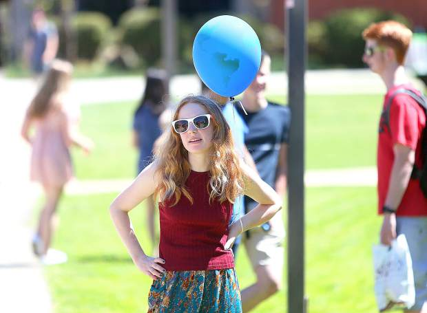 Ghidotti Early College student Lily Noble sports an Earth balloon during Sierra College's Earth Day and Health Fair event last Thursday. Booths from local health clubs and environmental organizations were on hand to offer information, invite activism and help folks become better stewards of the Earth.