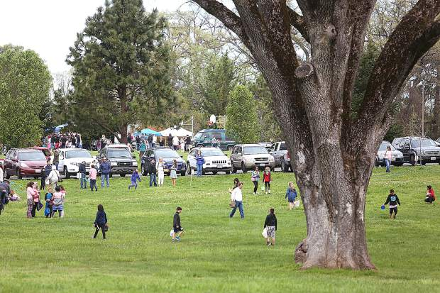 Children scour the grounds of Western Gateway Park in search of eggs during the annual hunt in Penn Valley. Hundreds of children and their guardians attended.