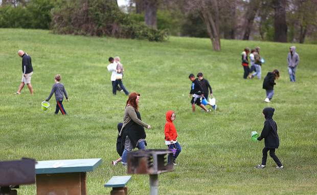 Kids scour Western Gateway Park in search of eggs Saturday morning.