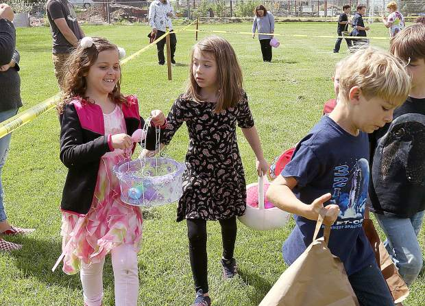 Kids walk to claim their prizes after finding specially marked prize eggs during the Grass Valley Moose Lodge event.
