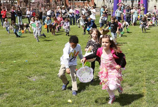 Children run into the fields of Grass Valley Charter School in search of eggs during the 46th annual Grass Valley Moose Lodge Easter Egg Hunt. Taking days to prepare for, the hunt was over in just a few minutes.