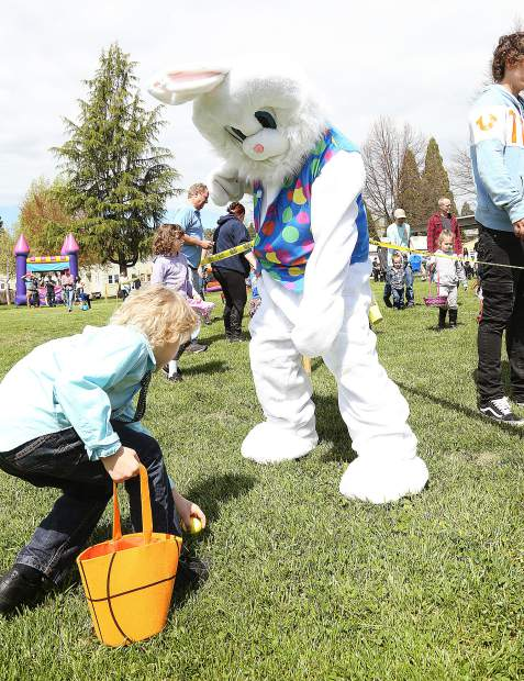 The Easter bunny helps kids find their eggs during Saturday's annual Moose Lodge hunt at Grass Valley Charter School.