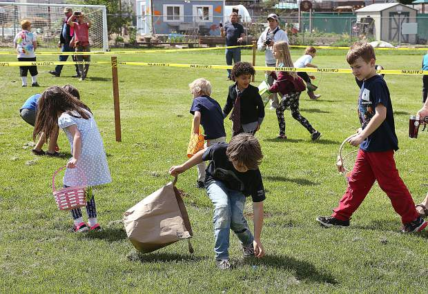 Children use easter baskets, paper bags, and whatever they could to collect as many eggs as possible during the Moose Lodge's event. Within a few minutes, every egg had been found.