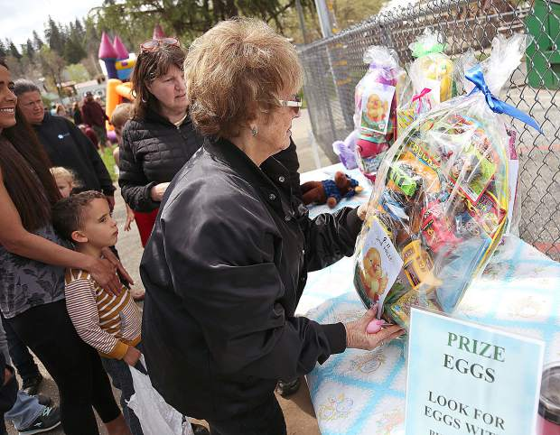 Prizes are doled out for children who found the special prize eggs with bunny ears on them.