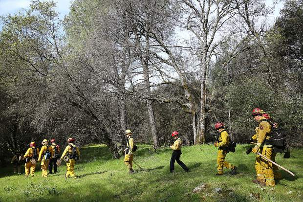 Area firefighters work on their spacing as they walk from an incident during Saturday's Lake of the Pines wildland urban interface fire drill.