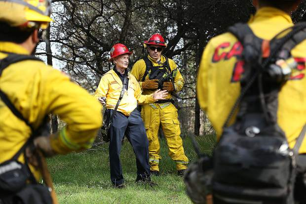 Retired Cal Fire Captain Charlie Jakobs talks to a group of firefighters about the importance of deploying fire shelters during Saturday's fire drill at Lake of the Pines.