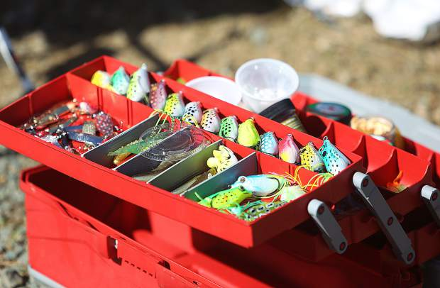 A neatly organized tackle box sits on the shores of Lions Lake during the annual trout fishing derby.