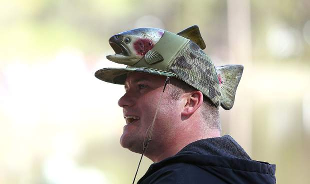 Jacob Mosley smiles from the shores of Lions Lake from under an eye-catching fish hat.