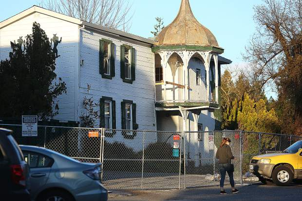 A chainlink fence encircles the rear of the National Exchange Hotel in Nevada City as restoration work continues on the historic building.