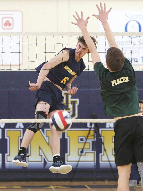 Nevada Union's Carter Depue spikes down one of his four kills during the Miners victory over Placer Tuesday April 2.