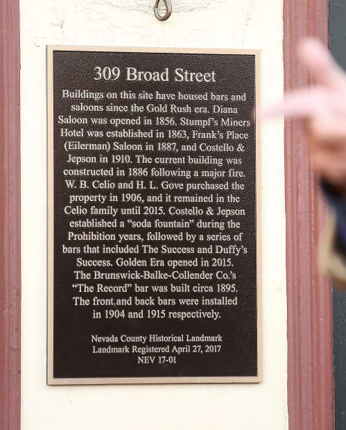 The plaque, title 309 Broad Street, highlights the storied past of the different businesses that occupied the space over the years.