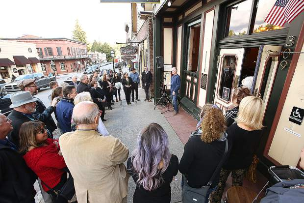 Steve Giardina, co-owner of the Golden Era Lounge, addresses the crowd gathered on the sidewalk in front of the building during a dedication of a new historical plaque by the Nevada County Historical Landmarks Commission Friday afternoon.
