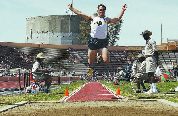 Steven Conrad of Nevada Union in the air for the Long Jump at the State Track Championships at Hughes Stadium, Sacramento, Saturday afternoon.