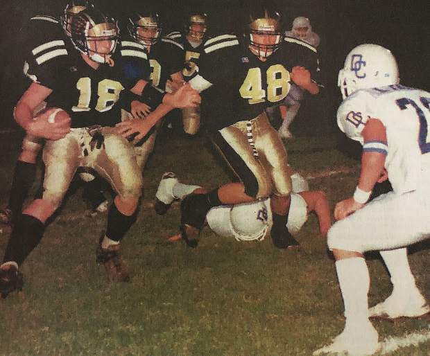 Spencer Havner, left, returns one of his three interceptions for the Miners against Del Campo in 2000. Havner nabbed seven interceptions his senior season, which ranks second all-time in Nevada Union history.