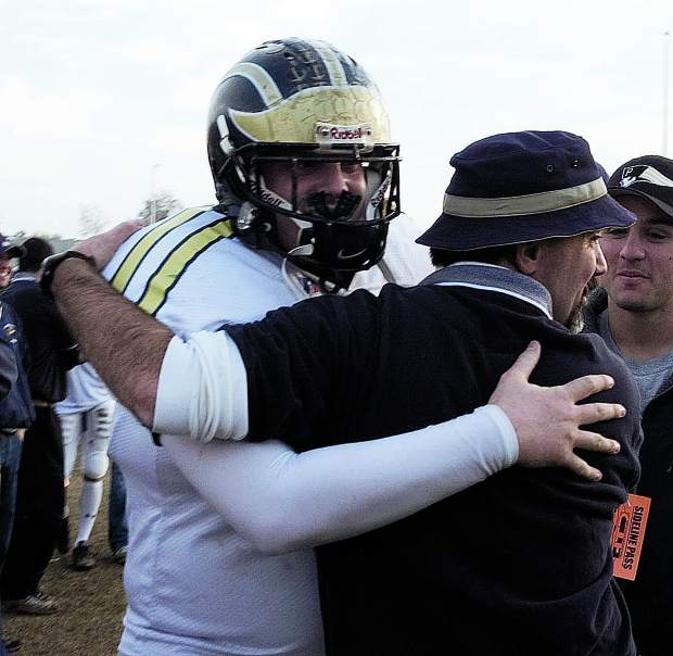 Brennan McFadden hugs Dave Humphers after beating Granite Bay in the City Championship Game. On the football field, McFadden was a dominant offensive lineman and tight end, who helped the Miners win the Metro League championship in 2003 and reach the Sac-Joaquin Section title game in 2004. He was a two-time All-Metro League First Teamer on the gridiron and was Nevada Union's Albert Ali Award winner his senior year.