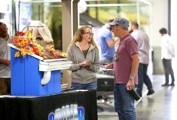 Megan White of Sacramento based Gutter Logic, shows off the Gutter Dome to an attendee of The Union's Home and Garden Show Saturday at the Nevada County Fairgrounds.