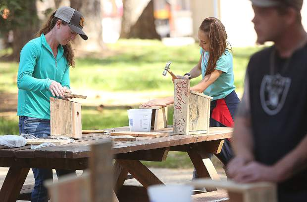 Rachael Perry and Ema Chapman put the finishing touches on their Hills Flat Lumber sponsored free birdhouses.