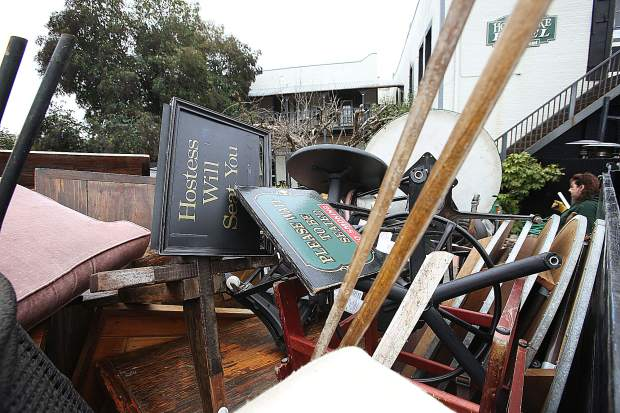 A junk-hauling company loads a trailer with furniture and items from Grass Valley's Holbrooke Hotel, which closed earlier this year, to accommodate remodeling efforts.