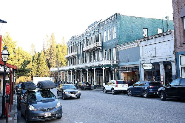 Business continues around the shuttered National Exchange Hotel on Broad Street in Nevada City earlier this week.