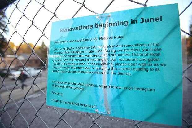 Signs stating the reopening of the National Exchange Hotel would occur during winter of 2018 remain up on the chainlink fence surrounding the closed portions of the hotel. The re-opening of the hotel has been pushed back.