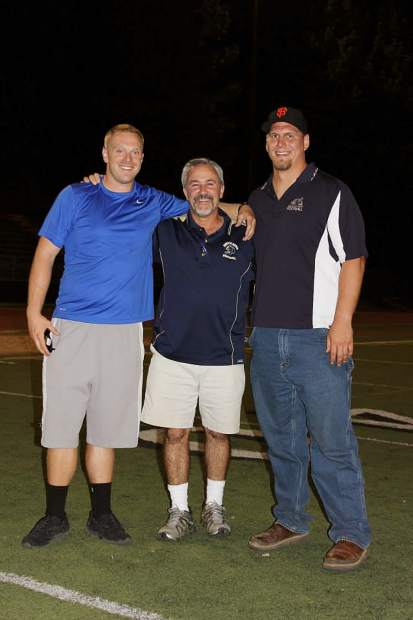 Dave Humphers, middle, with former players Brennan McFadden, left, and Andrew Jackson.