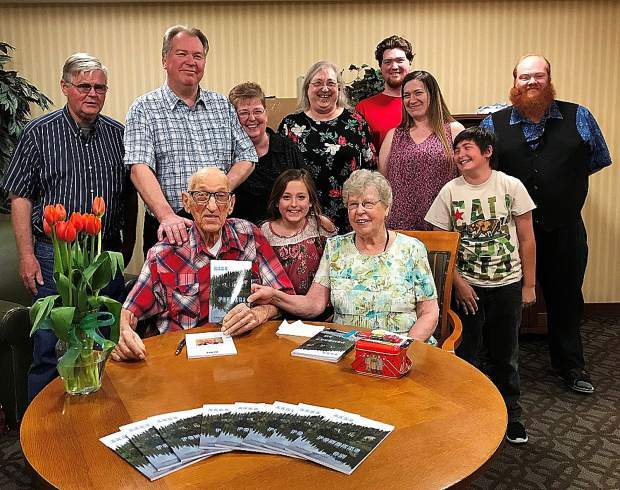 "Zeke Lewis, age 90, (seated at left), published a book of his short stories and poems called ""Zeke Ponders On."" He was encouraged by his family as well as his family of supporters from Hospice of the Foothills."