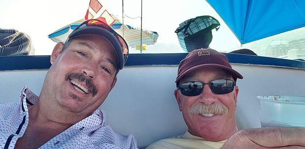 (Left to right) Kenn Rutledge and Rich Fuxjager are back donating their time to nonprofits and community events after their relaxing vacation in Puerto Vallarta.