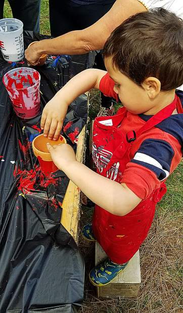 Some kids got as much paint on themselves as they did their plant pots at The Union's Home, Garden, and Lifestyle Show.
