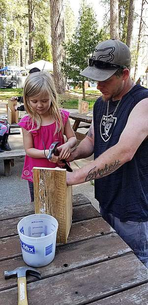 The Union's Home, Garden, and Lifestyle Show at the fairgrounds featured many children's attractions, including birdhouse building sponsored by Hills Flat Lumber. Travis Allan and five-year-old daughter Elliana of Penn Valley teamed together to build a special birdhouse.