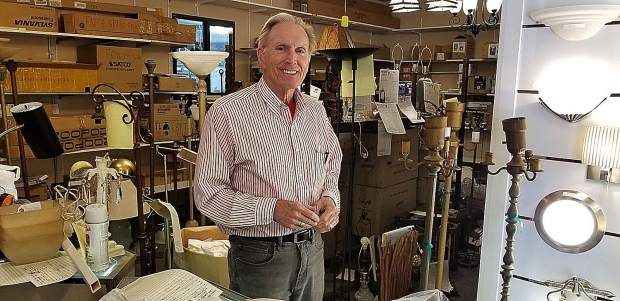 It looks like a lamp graveyard at Illumination --The Lamp Doctor, with dozens of lamps awaiting repair due to incandescent bulbs frying the lamps' sockets.  Manager Peter Haugen recommends switching to LED (Light-Emitting Diode) bulbs, which can last up to 27 years.