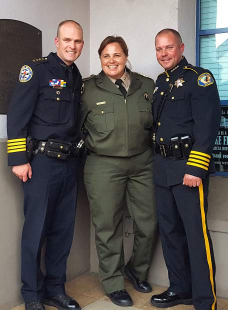 Nevada City Police Chief Chad Ellis, right, poses after being sworn in with Grass Valley Police Chief Alex Gammelgard, left, and Nevada County Sheriff Shannan Moon Wednesday.