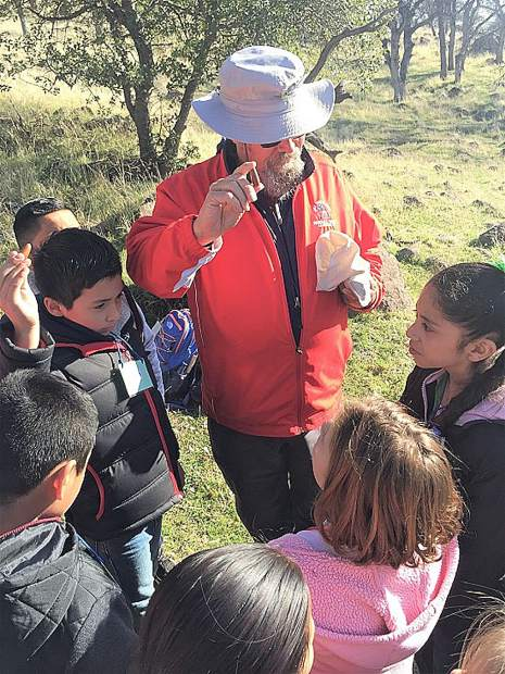 Steve Roddy works with junior conservationists.