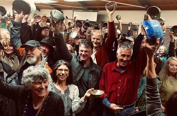 Bowls handcrafted and donated by talented local potters and woodturners are joyfully held high at the Hospitality House Empty Bowl fundraiser.