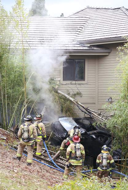 The scene on Ventana Sierra Drive earlier this month when a Kia sedan careened into the side yard of a home and caught fire.