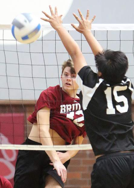 Bear River High School's Jace Rath watches one of his forceful spikes fly past a Pioneer player for a point during their win over the Patriots in three straight sets earlier this month.
