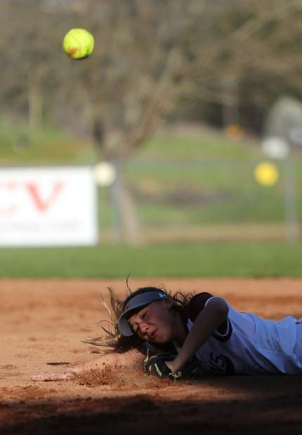 Bear River softball second base Gabi Corralejo tosses the ball to first for the out as she takes a dive into the dirt head first during the Lady Bruins' 8-5 loss to the Nevada Union Lady Miners March 21.