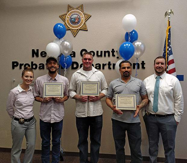 Post Release Community Supervision (PRCS) Graduation. From left to right, Deputy Probation Officer III RobinTamietti, Graduate Nicholas Reyes, Graduate Stanislav Matul, Graduate Vincent Delavega, Deputy Probation Officer II Josh Browning.