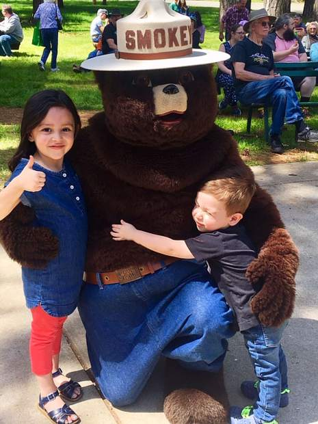 Marley Jae and Rowan Ginzales with Smokey the Bear and goats and The Union's Home and Garden show this past weekend.