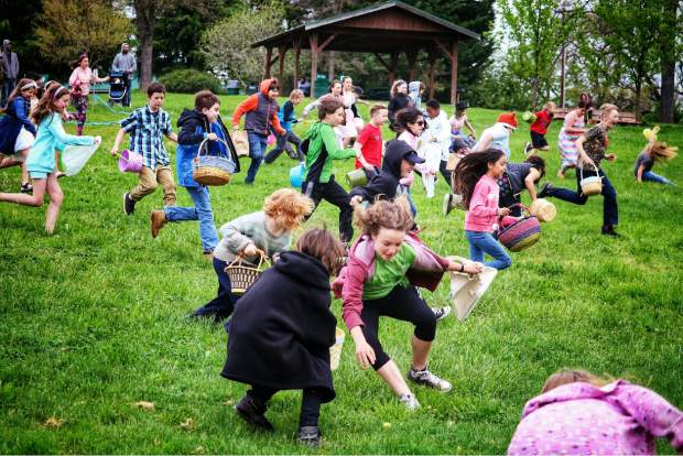 Look at those faces! Kids scramble to find treasures at the annual Easter egg hunt at Western Gateway Park in Penn Valley.