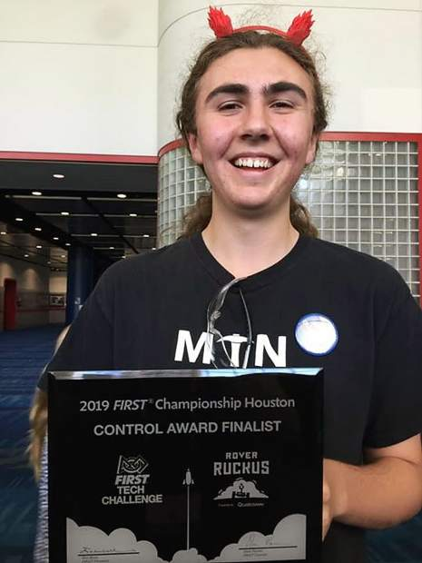 "NU Senior Kelly Muir holds the teams ""Control Award."" Part of the events includes the FIRST World Championship Conference, with sessions on topics ranging from technical skills to fundraising to networking. The teams software captain, Kelly Muir, presented a conference session on Motion Planning and Control in FTC."