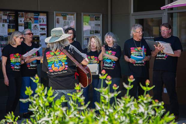 The New Peace Choir performs at BriarPatch on Earth Day 2019.