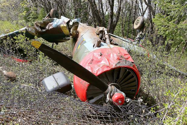 The Nanchang CJ-6 and its occupants went over the end of the runway at the Nevada County Airport after landing and being unable to bring the plane to a stop.