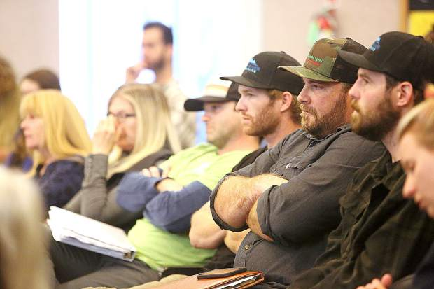 Faces in the crowd watch and listen as Nevada County planners discuss the proposed cannabis cultivation ordinance.