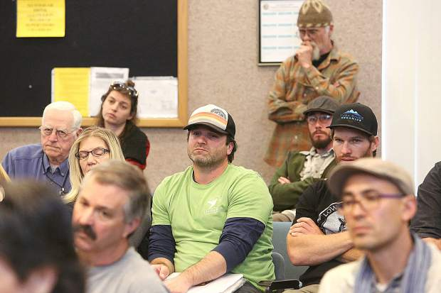 Folks who have been waiting years for the outcome of a Nevada County cannabis cultivation ordinance sit and wait during another county meeting on the process Thursday at the Rood Government Center.